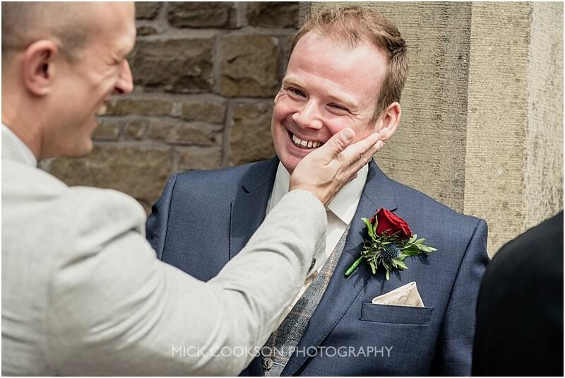 smiling groom at stirk house