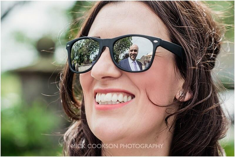 reflection of a wedding guest in sunglasses