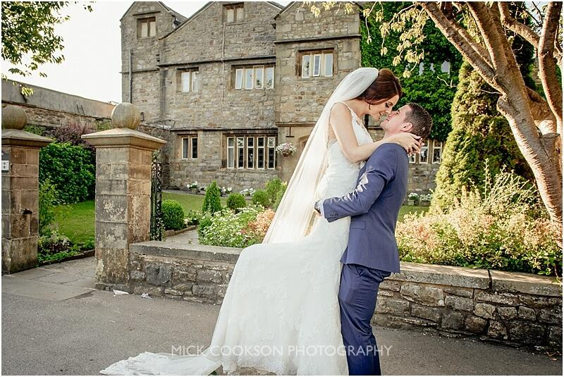 groom lifts his bride at stirk house