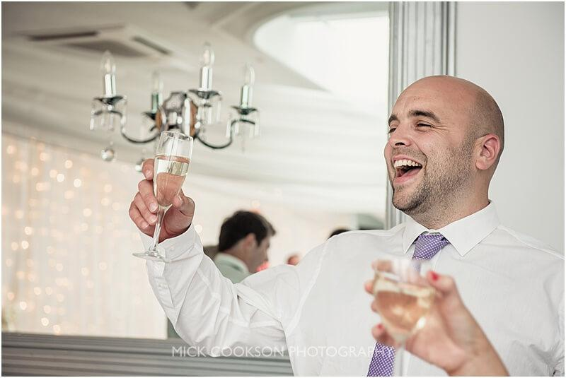 wedding guest raising a toast at stirk house