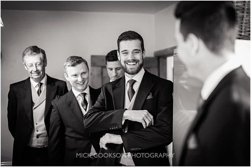 groomsmen sharing a joke