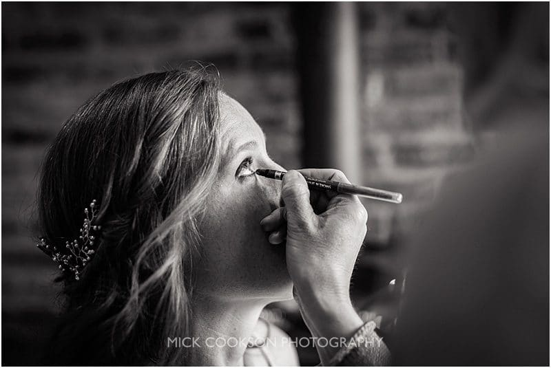 bride putting on her makeup