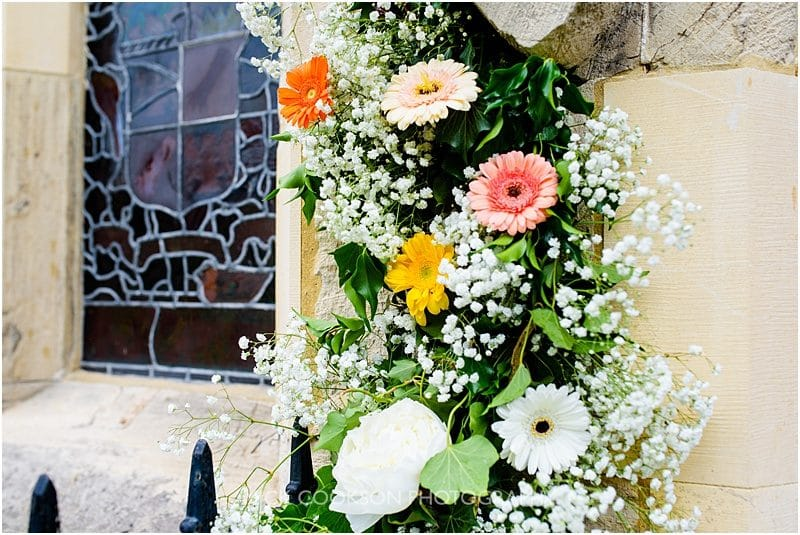 flower arch on church door