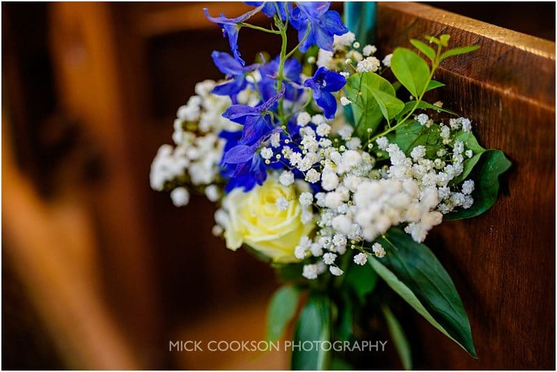 wedding flowers on pews