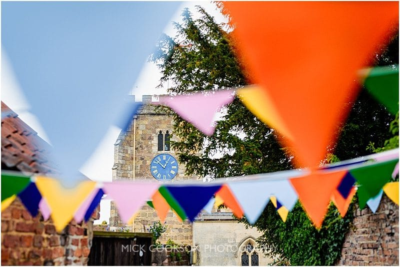 church clock amongst wedding bunting