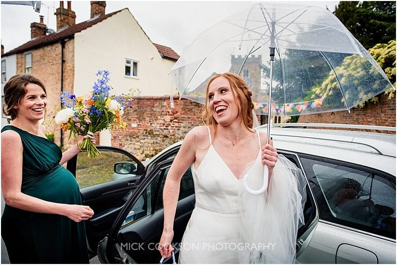happy bride getting out of the car