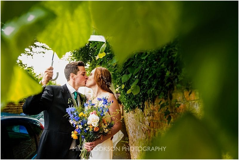 a quick kiss for the bride and groom