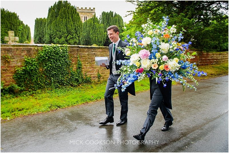 groomsmen hidden by flowers