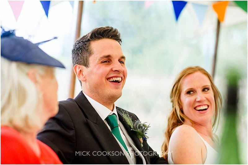 happy groom at a marquee wedding in york