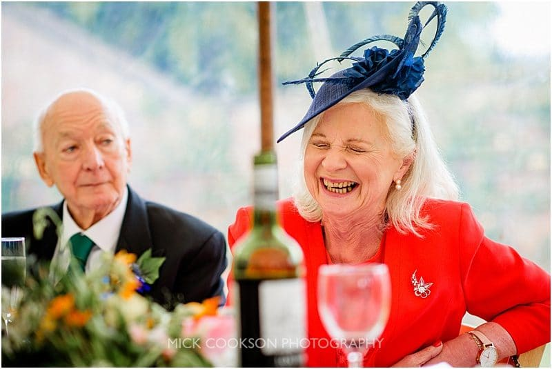 laughing mother of the groom at a marquee wedding in york