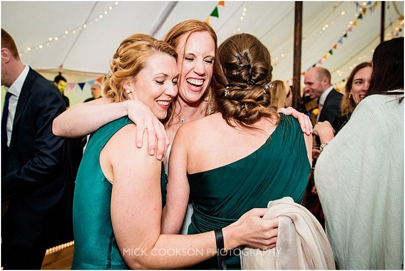 hugs for friends at a marquee wedding in york
