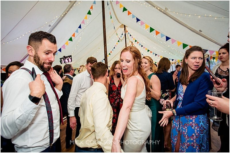 bride having fun at a marquee wedding in york