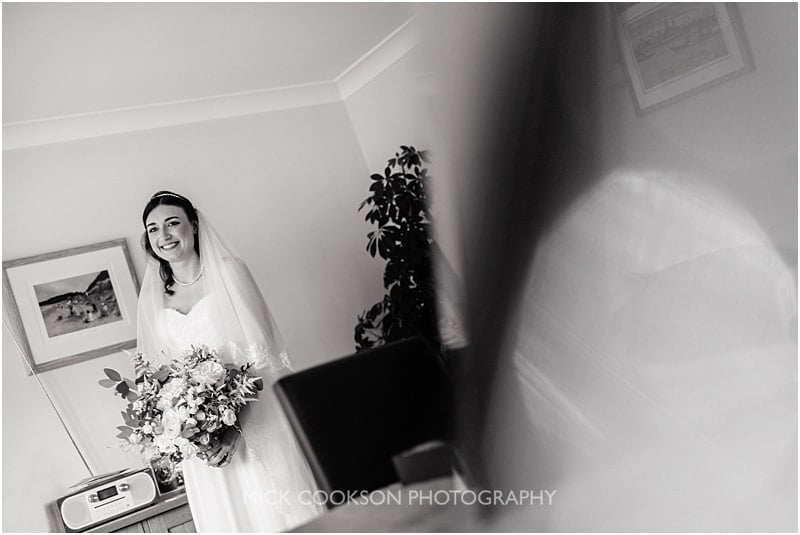mono photo of a bride in a mirror