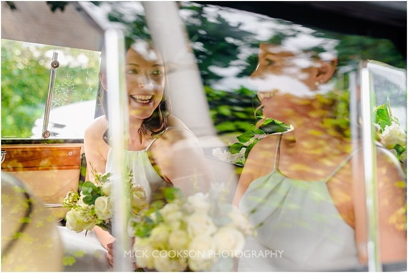 excited bridesmaids in a wedding car