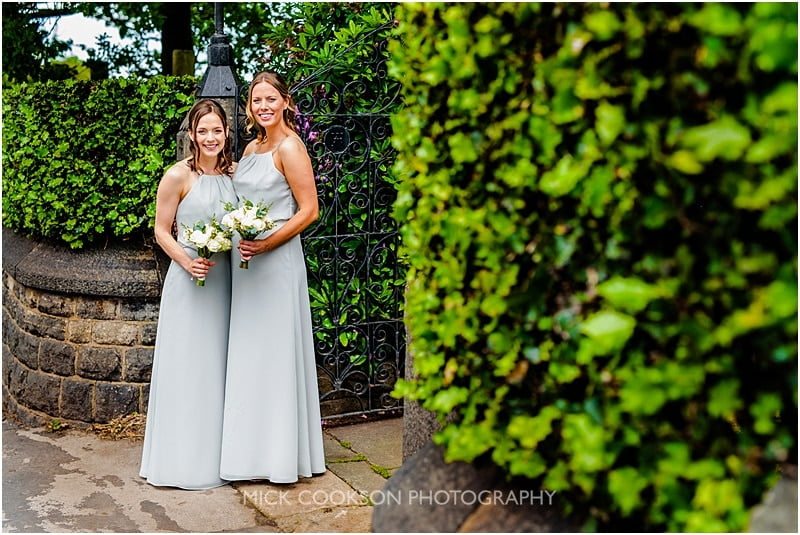 bridesmaids posing outside church