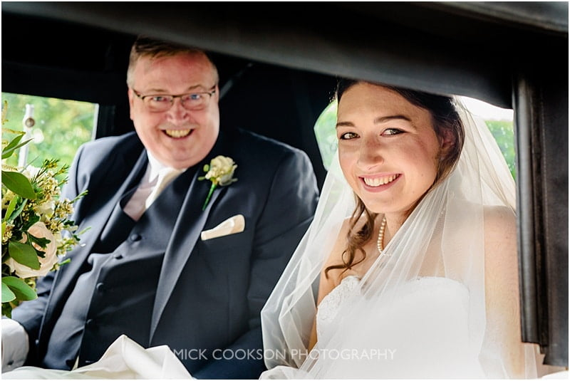 bride and her dad in the wedding car