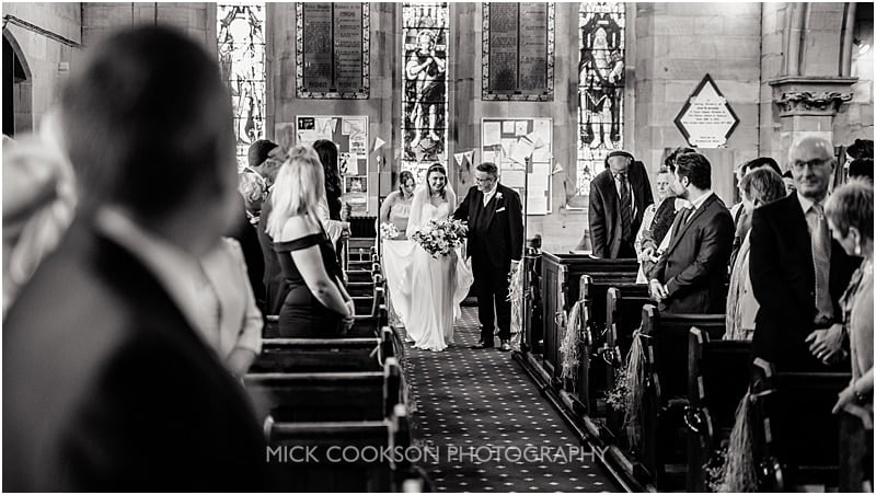 bride walking down the ailse at christ church