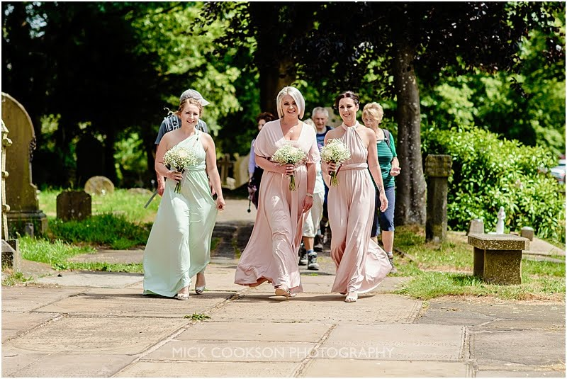 stunning bridesmaids dresses at a wedding