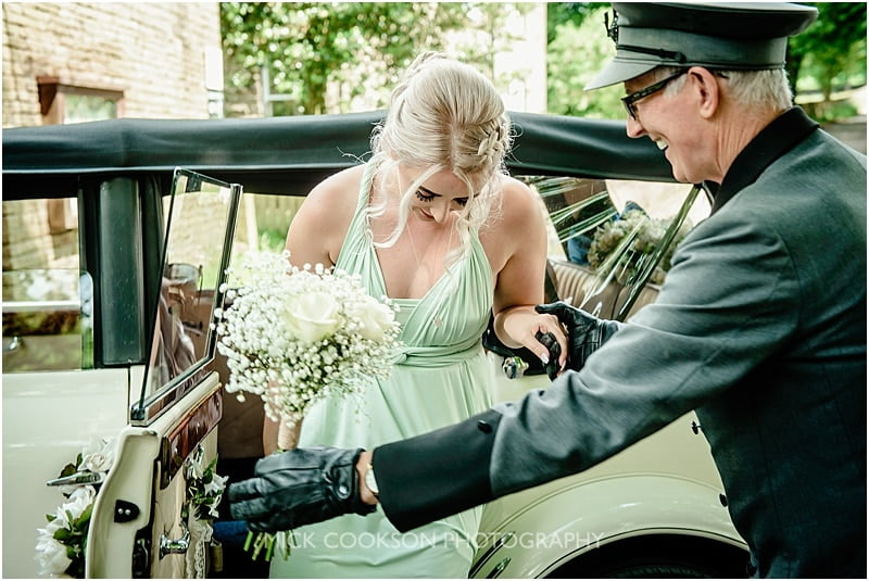 bridesmaid getting out of a wedding car