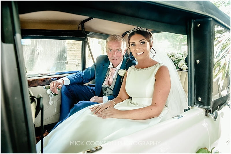 bride and her dad in a wedding car