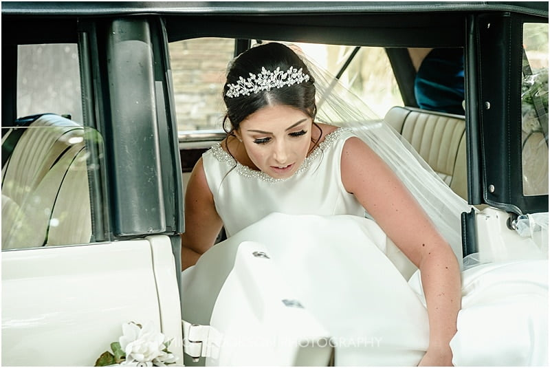 bride getting out of the wedding car