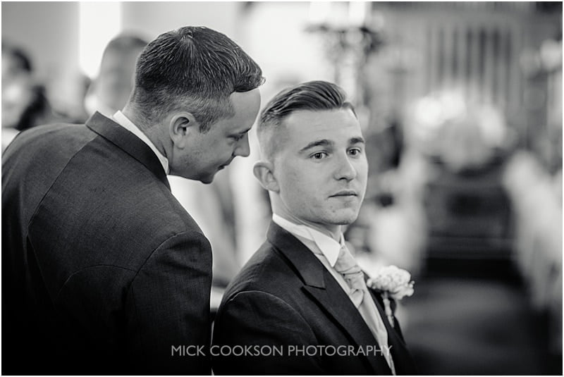 best man whispers something to the groom
