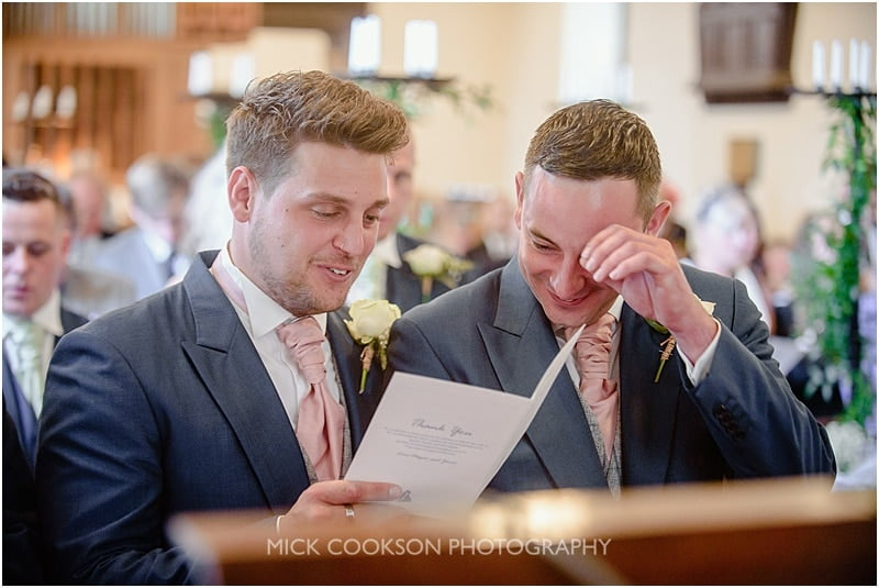 best man sharing a joke in church