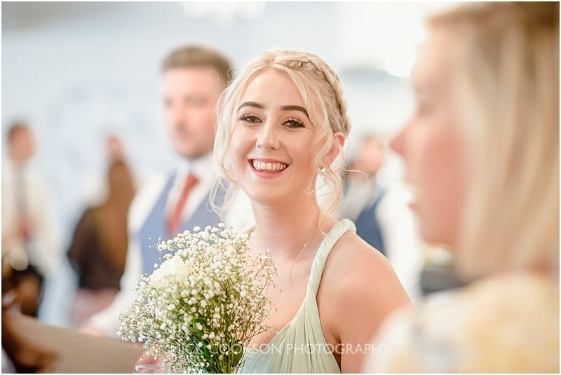 smiling bridesmaid at a deanwater hotel wedding
