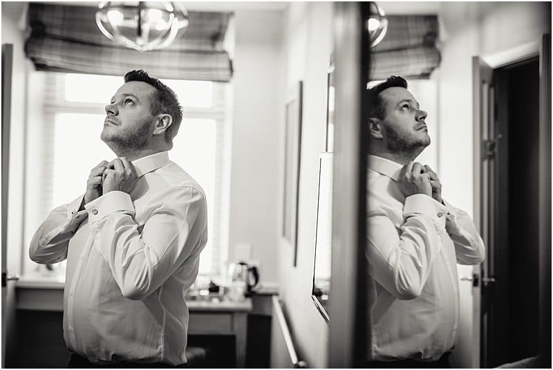groom getting ready for his falcon manor wedding