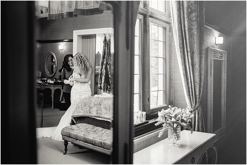 bride getting ready for her falcon manor wedding