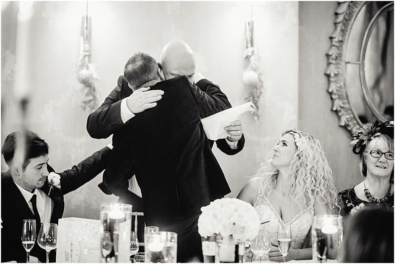 groom hugs the best man at falcon manor
