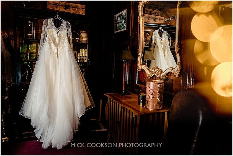 wedding dress hanging at a mitton hall wedding