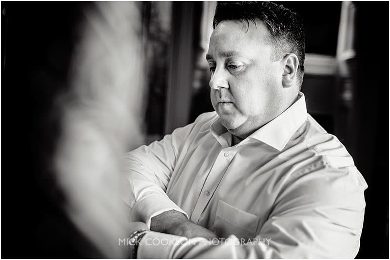 pensive groom at a mitton hall wedding