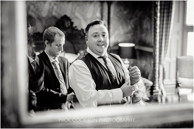 groom in the mirror at mitton hall