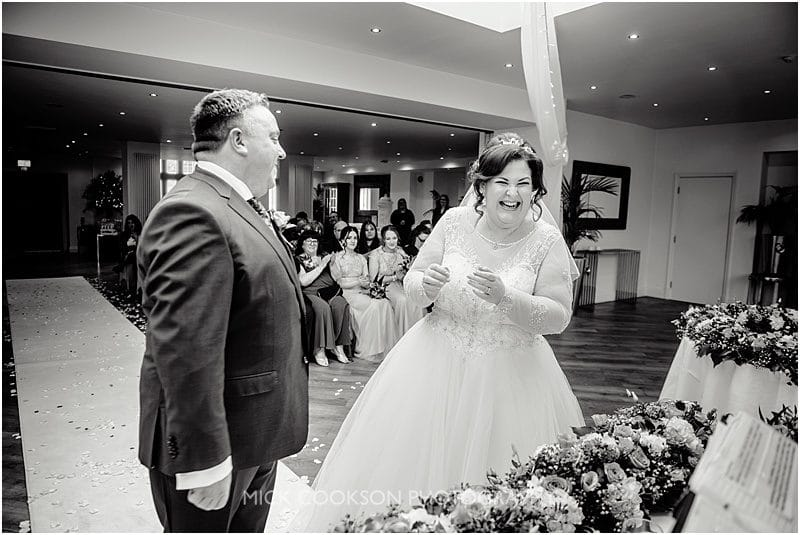 mitton hall wedding ceremony laughing bride