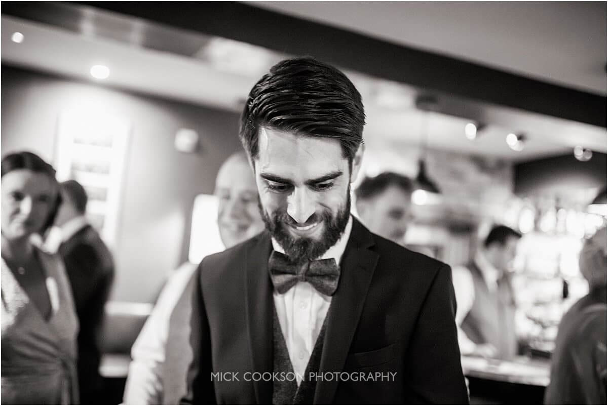 groom in the bar at the white hart at lydgate