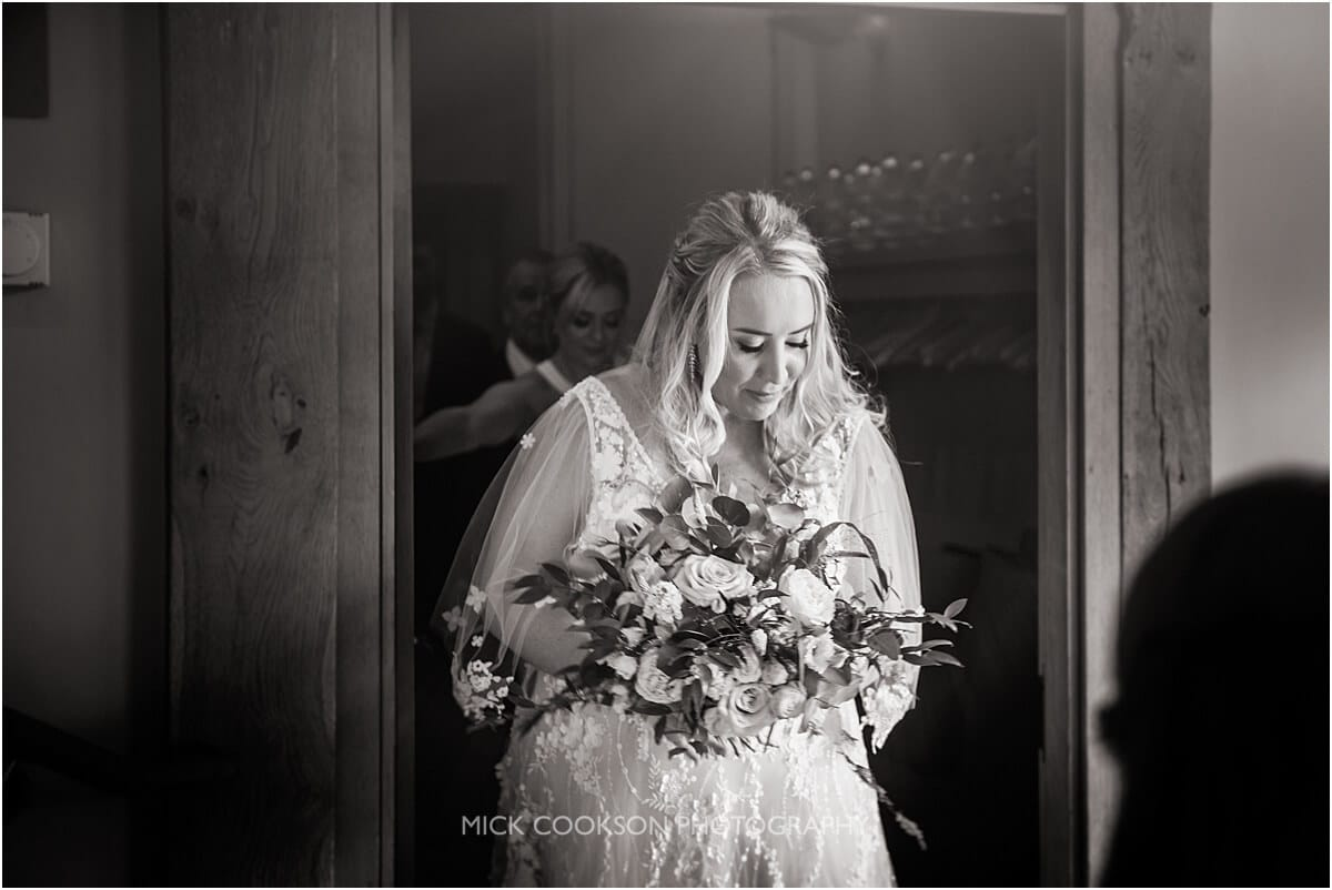 bride arriving to be married at the white hart at lydgate