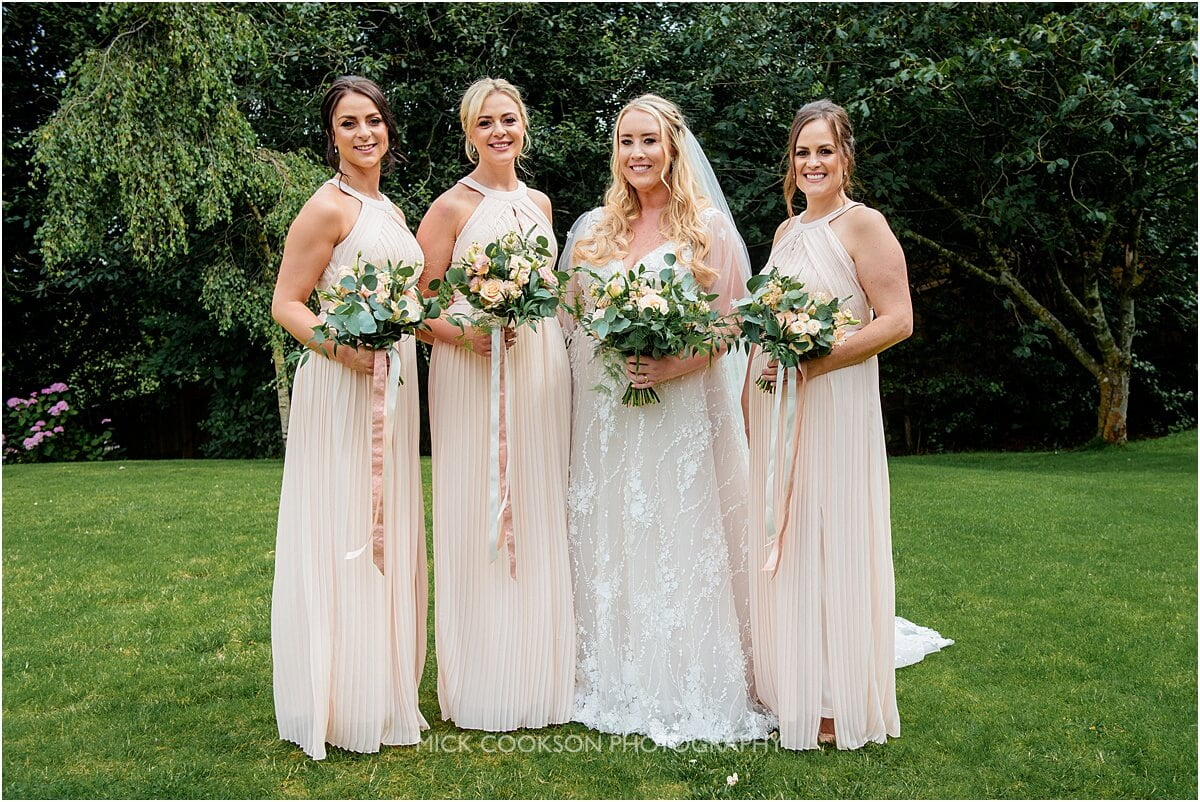 bride and bridesmaids photo at the white hart at lydgate