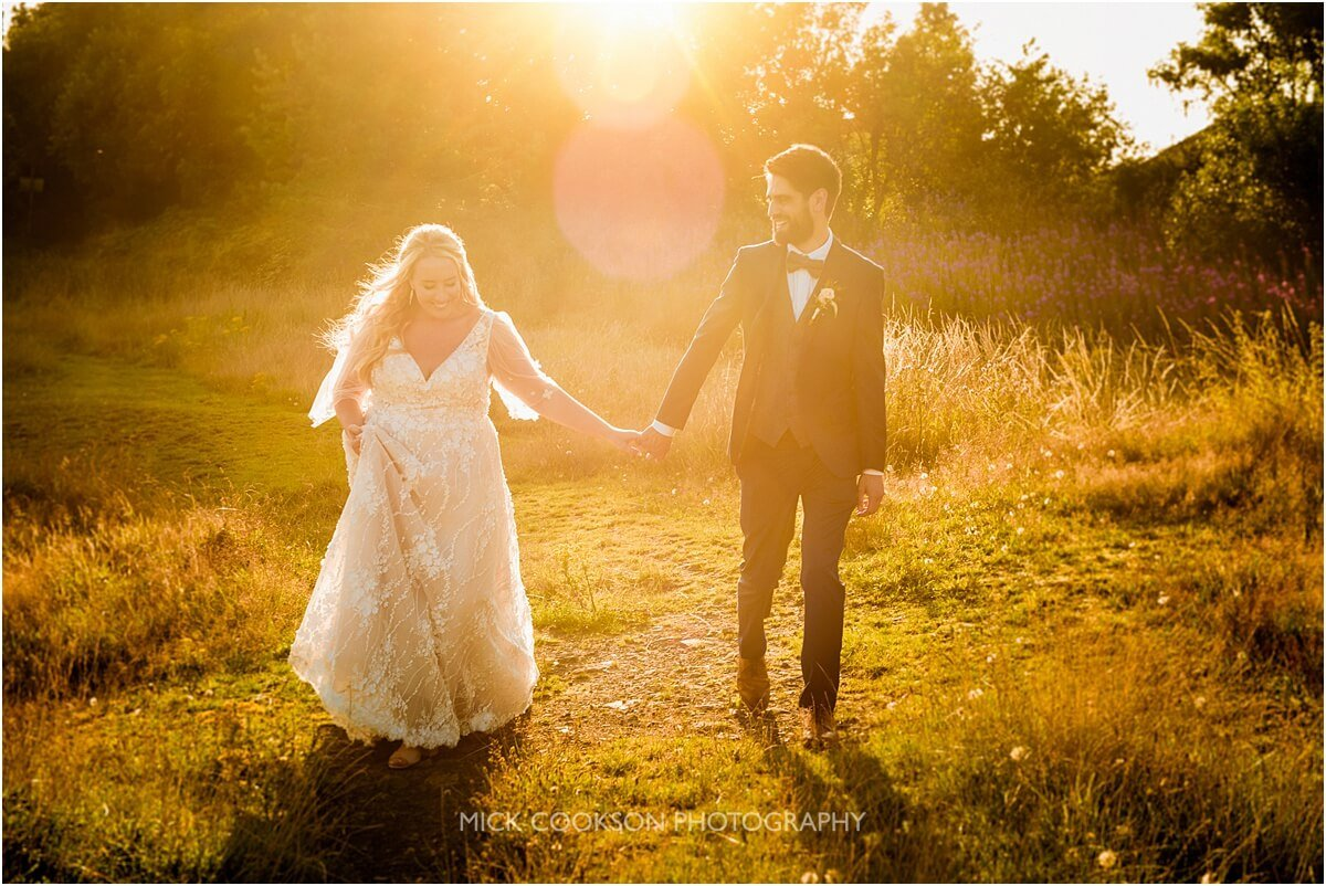 sunset photo of a bride and groom at the white hart lydgate