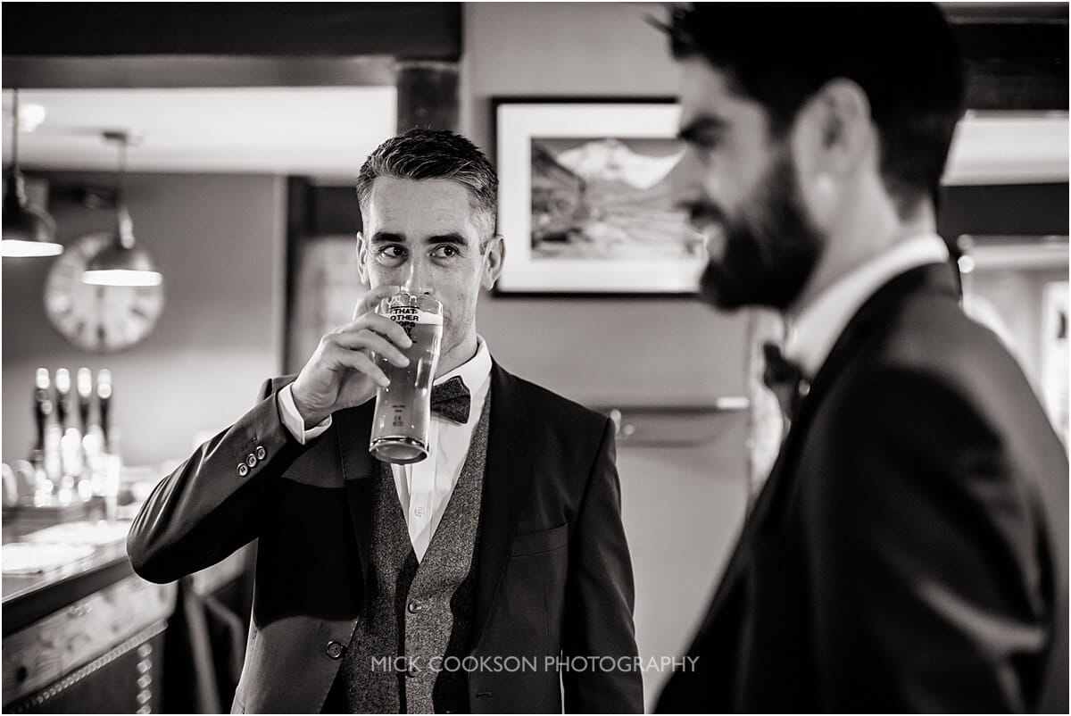 groom and best man at at the white hart lydgate