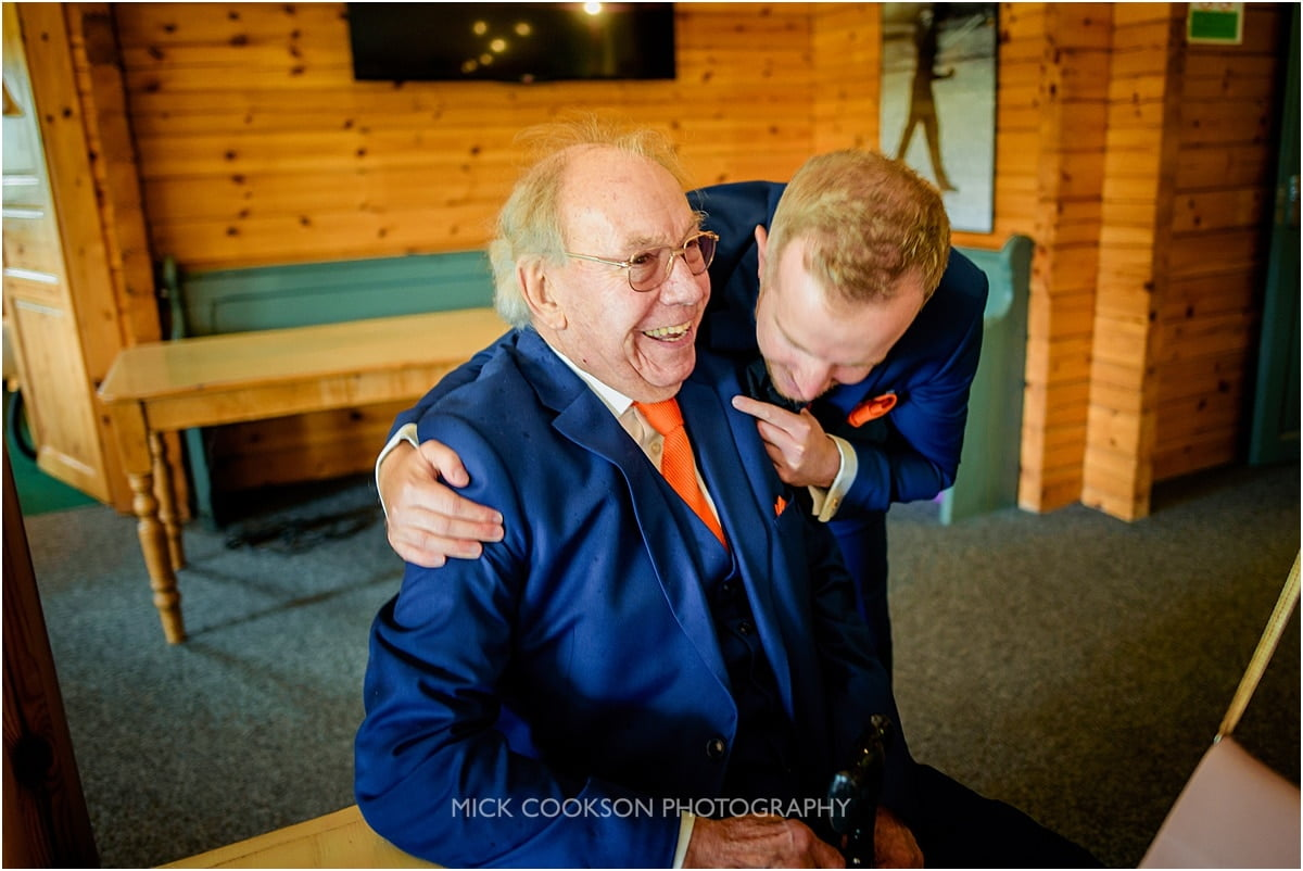 groom and grandad laughing