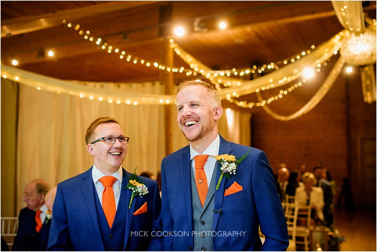 groom and best man sharing a joke