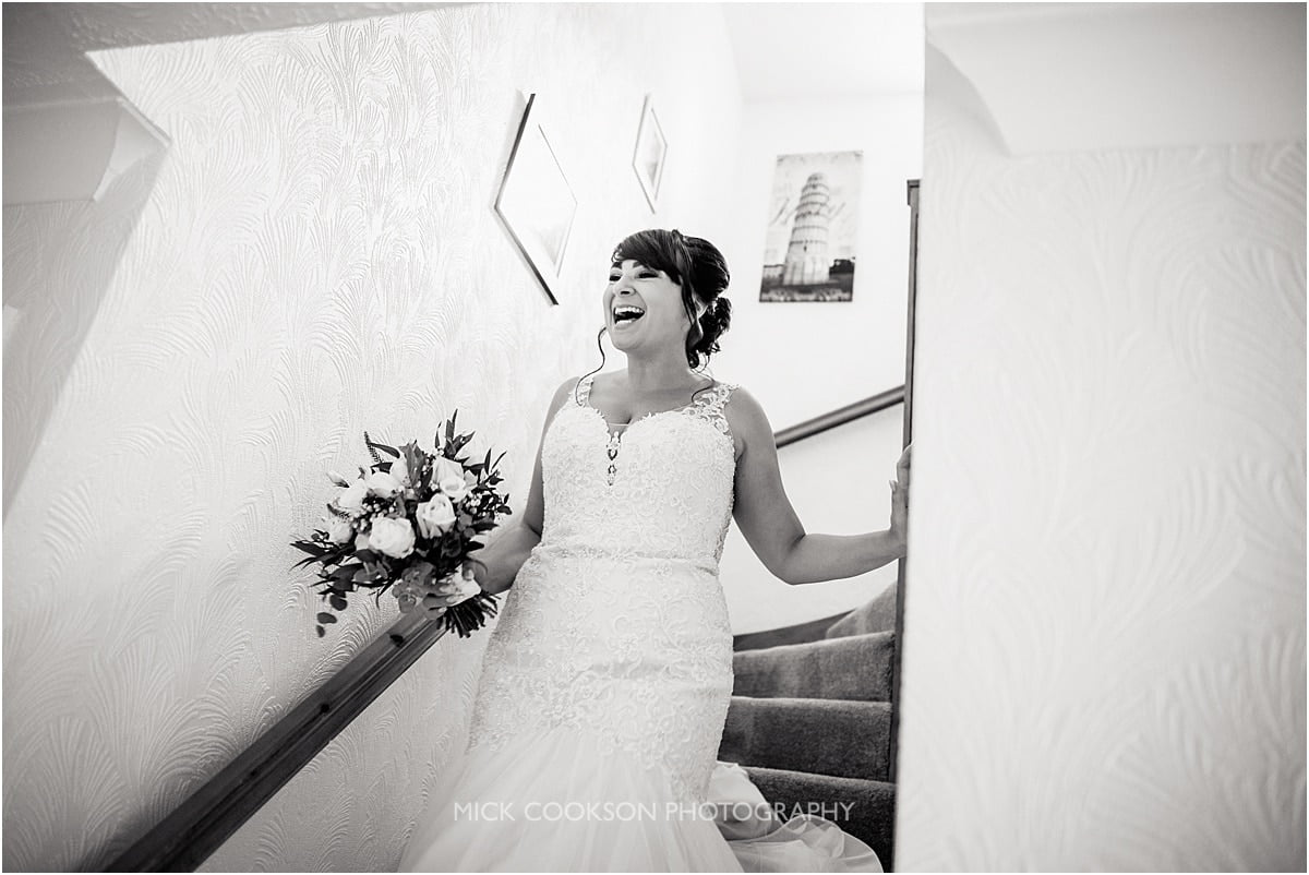 happy bride coming down stairs