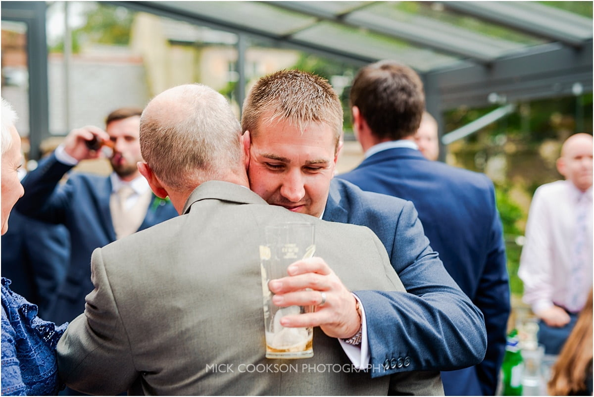 wedding guests hugging at rivington hall barn