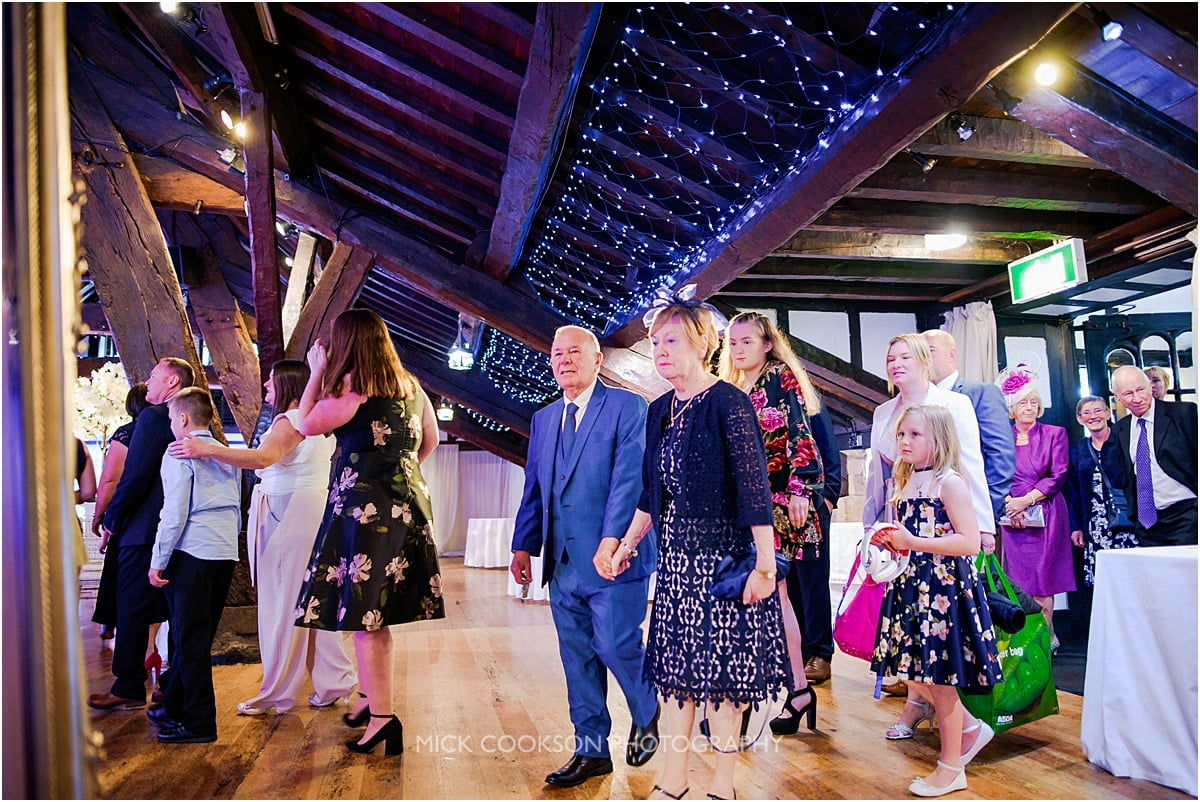 wedding guests arriving at a rivington hall barn wedding