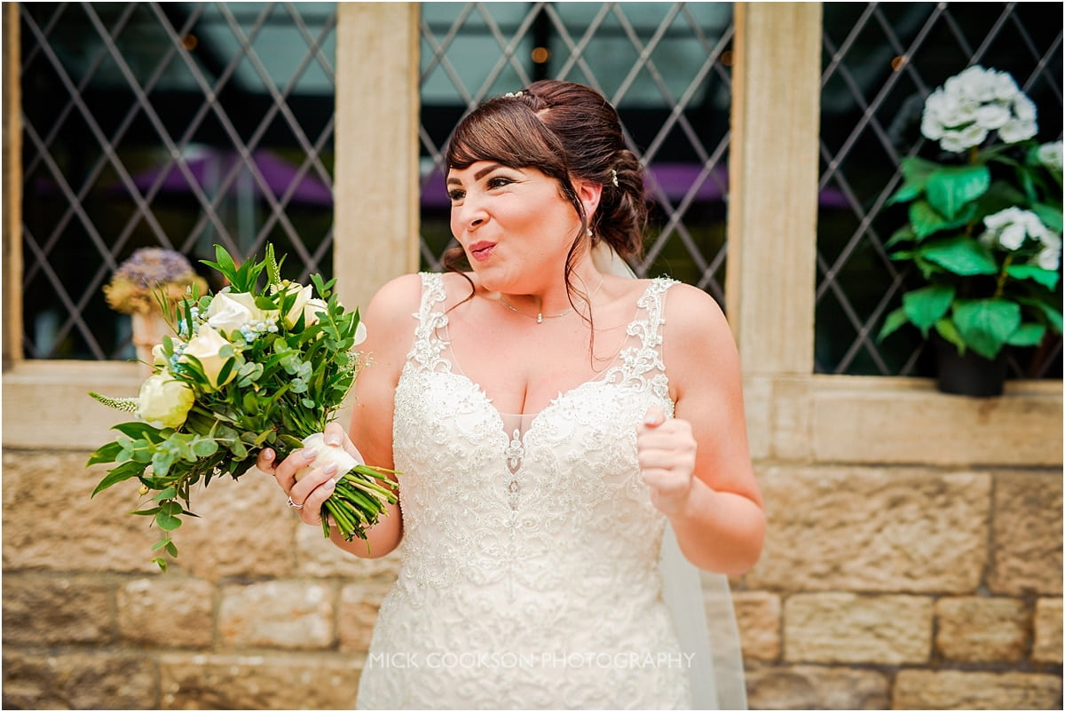 excited bride at her rivington hall barn wedding
