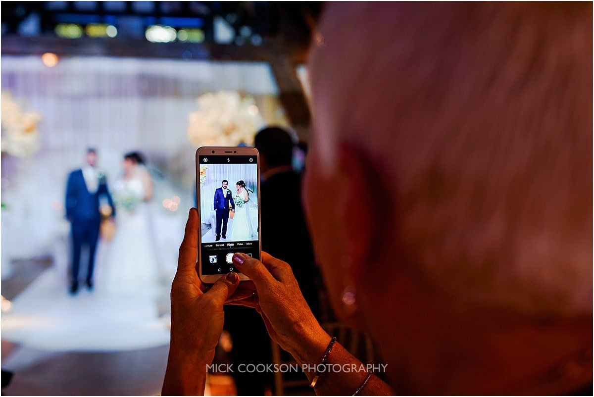 wedding photo on a phone at rivington hall barn
