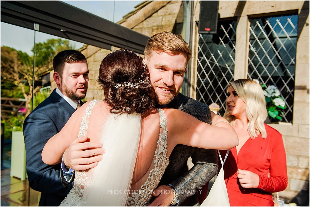 wedding guests at a rivington hall barn wedding