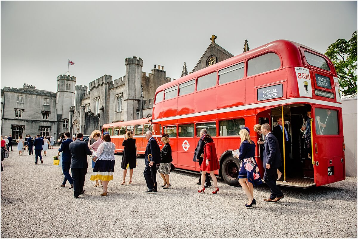 wedding guests at leighton hall arrive on a bus