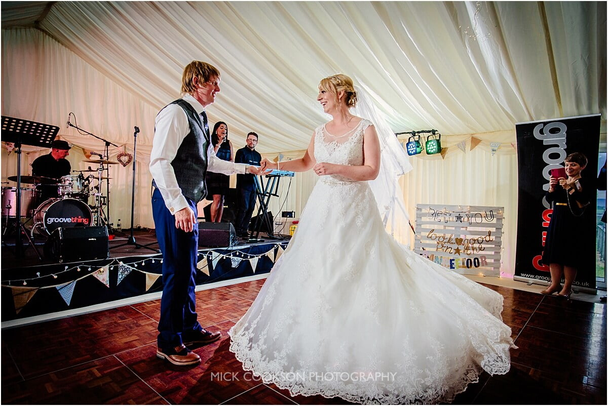 wedding first dance in a marquee
